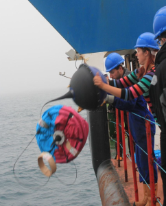 A drogued GPS drifter being deployed from the RRS James Cook.  The drogue is packaged in water-soluble cardboard, and forms an 8 metre-long 'sock' when deployed.